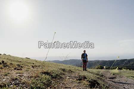active senior man standing while looking