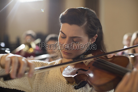 violinist performing with eyes closed