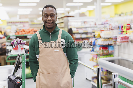 portrait smiling confident male grocer working