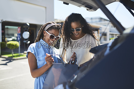 women looking into shopping bags in