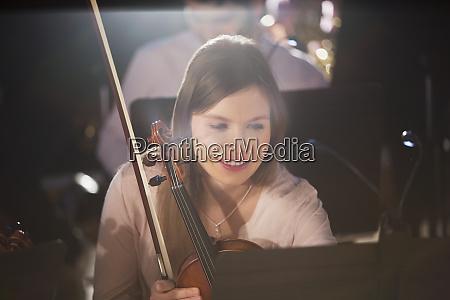 violinist viewing sheet music