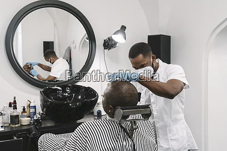 barber wearing surgical mask and gloves