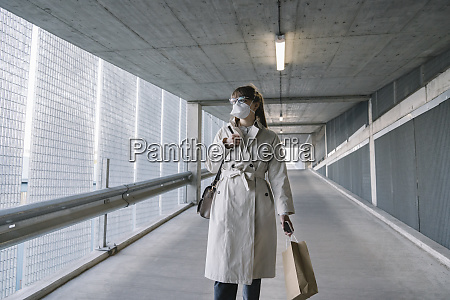 woman wearing face mask walking in