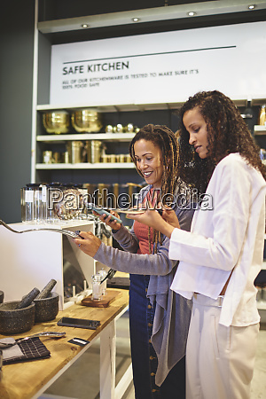 women with smart phone shopping in