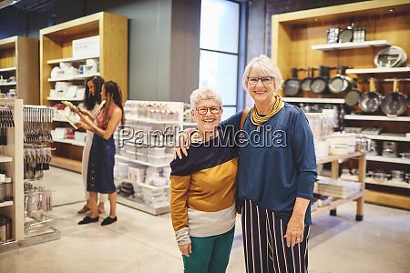 portrait happy senior women friends shopping