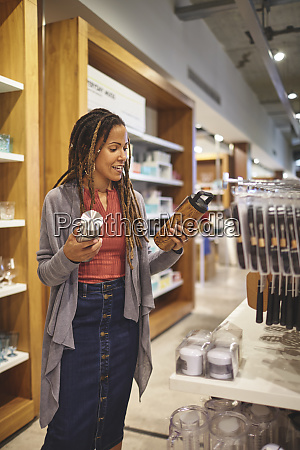 woman shopping for insulated drink containers