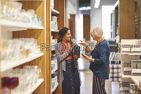worker helping woman shopping in home