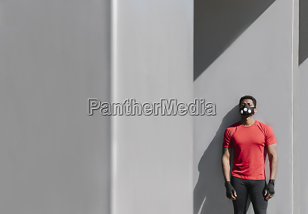 sportsman wearing face mask leaning at