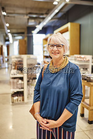 portrait confident smiling woman in home