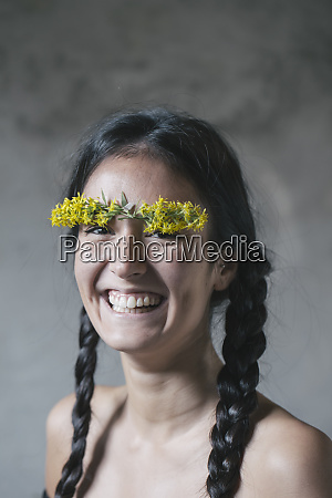 cheerful young woman with flower stuck
