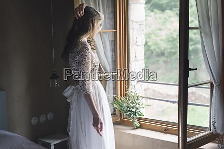 young woman in elegant wedding dress