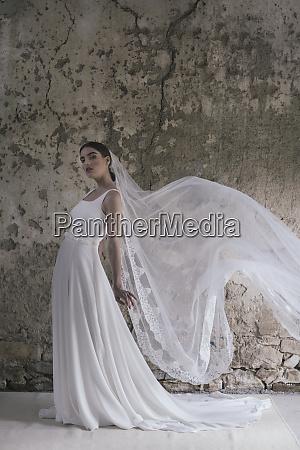 young posing woman wearing wedding dress