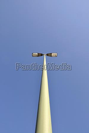 street light standing against clear blue