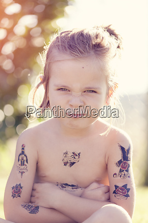 girl with fake tattoos