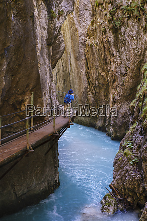senior woman on footbridge at wasserfallsteig