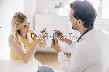 doctor explaining using of asthma inhaler
