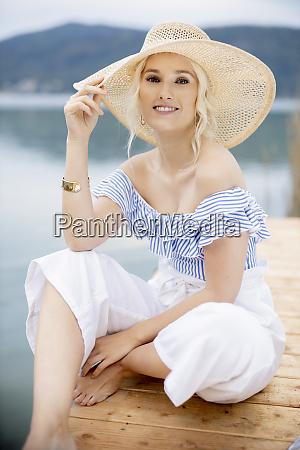 portrait of fashionable blond woman sitting