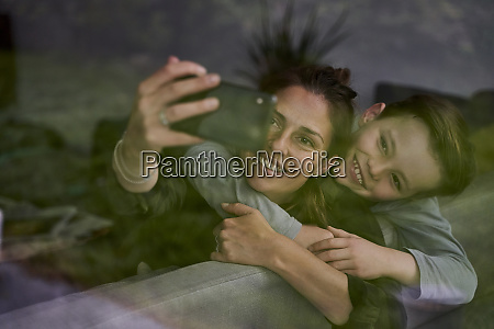mother taking selfie with son while