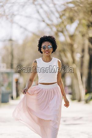 stylish woman wearing sunglasses while walking