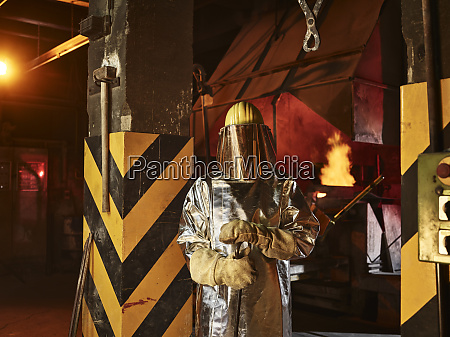 worker wearing protective workwear standing in