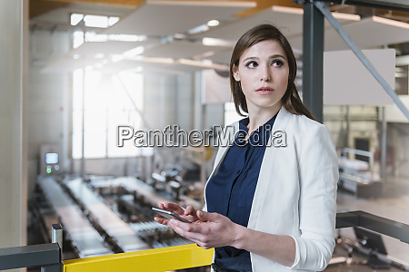 female manager holding digital tablet looking