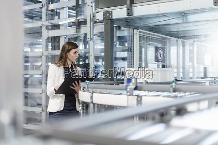 female manager holding file while examining