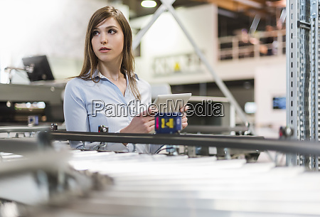 female manager holding digital tablet while
