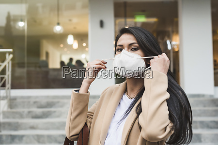 woman with protective mask in city