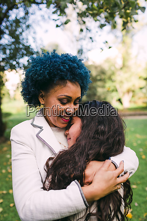 loving mother with blue hair embracing