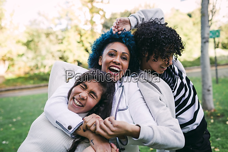 carefree children playing with mother in