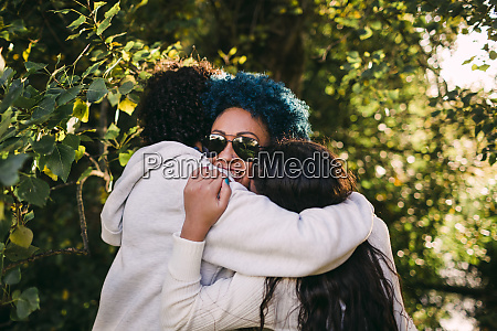 loving children embracing mother with blue