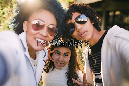 mother and son wearing sunglasses while