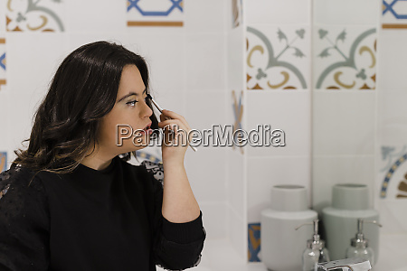 young woman with down syndrome applying