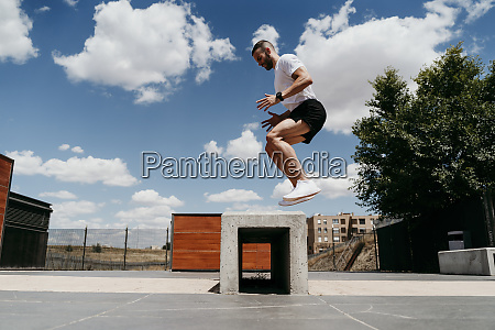 male athlete jumping outdoors