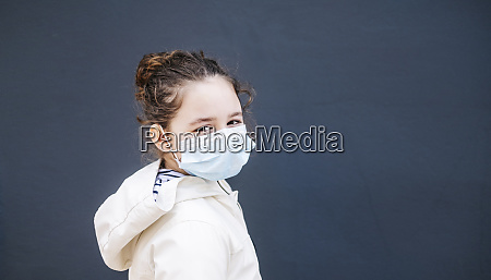 girl with surgical mask in front