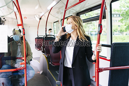 businesswoman on the phone wearing protective