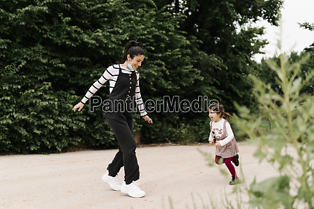 cheerful mother and daughter playing on
