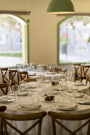place setting on tables in restaurant
