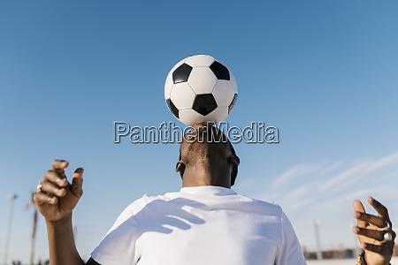 close up of young man balancing