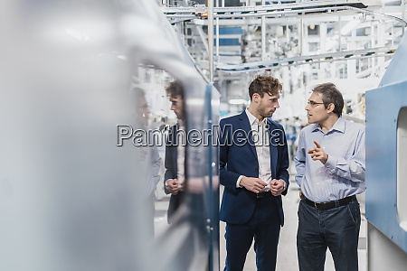 two businessmen having a meeting in