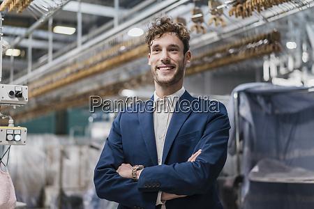 mature businessman in a factory