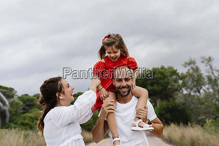 cheerful family enjoying at countryside against