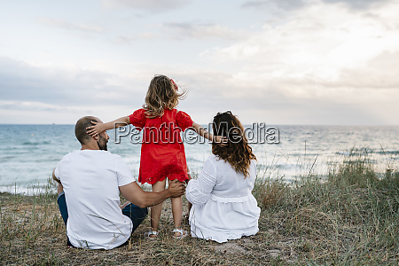 family spending quality time at beach