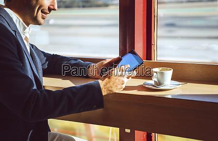 smiling businessman using digital tablet at