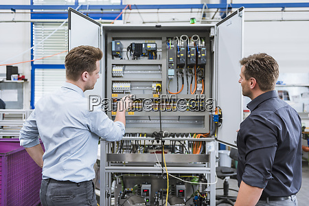 two technicians working on circuit in