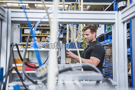 man operating a machine in factory