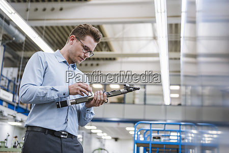 businessman examining a product in a