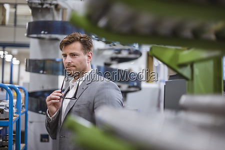 portrait of a businessman in factory