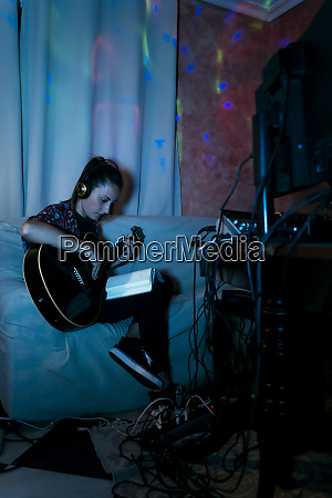 female musician reading book while playing