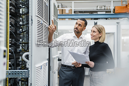 businessman and woman with papers at
